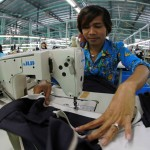 A worker sews a garter to a skirt in a garment factory outside Phnom Penh, Cambodia. Photo by World Bank, Flickr. Licensed under CC BY-NC-ND 2.0.