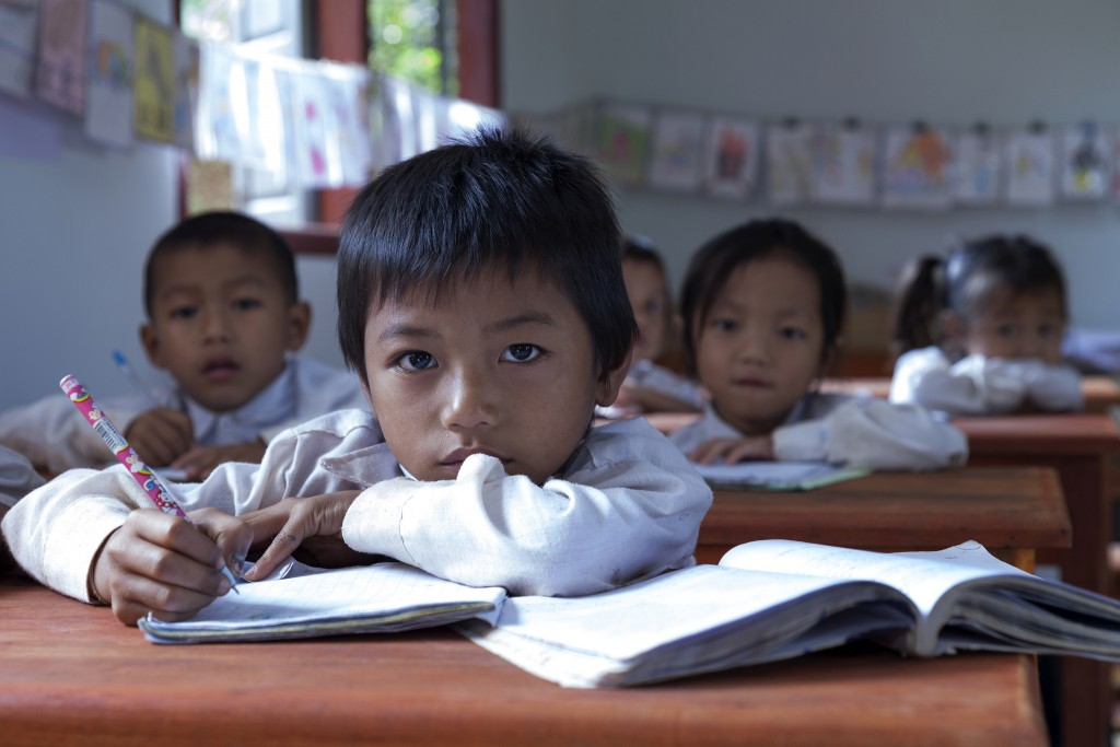 Primary school students in Oudomxay province, Laos. Photo by World Bank, Flickr, taken 16 November 2012. Licensed under CC BY-NC-ND 2.0.