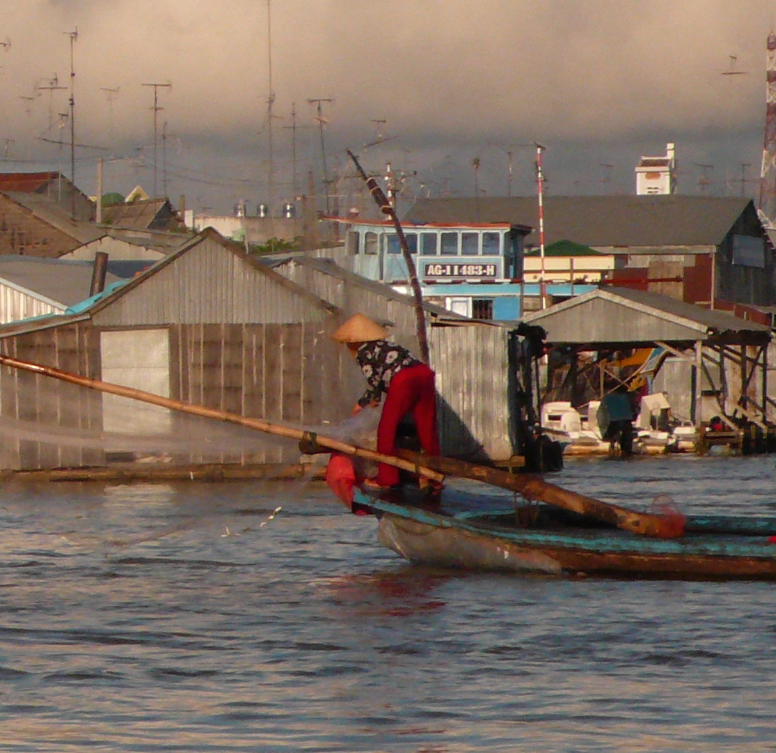 Mekong River fishing. Photograph by Christine Andrada (cropped). Licensed under Creative Commons Attribution-Non Commercial 2.0.
