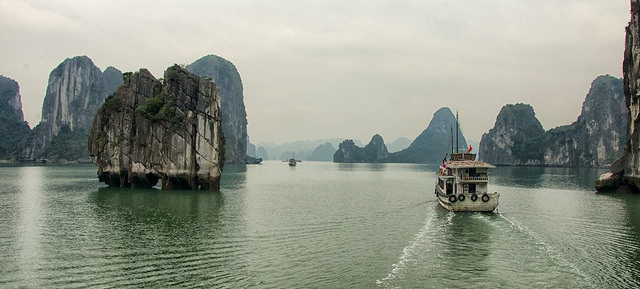 The picturesque and biodiverse limestone karsts and caves of Vietnam's Ha Long Bay have made it a World Heritage site.  Photo by Bob DeGraff, taken on 21 February 2015. Licensed under Creative Commons Attribution-NonCommercial-NoDerivs 2.0 Generic.