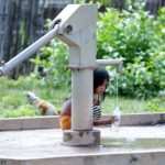 A child uses a groundwater pump to fill a water bottle last year. With the Kingdom facing water shortages and reliance on groundwater increasing, authorities are concerned the government's relief budget will not be enough to cover the cost of deeper water wells. Hong Menea