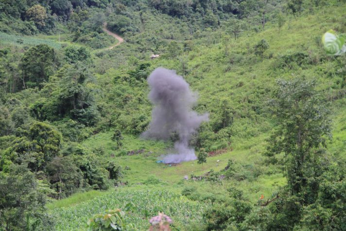 A controlled explosion of a UXO in Xieng Khouang province, helping to make the field safe for the farmer to expand their crops. Photo by Mines Advisory Group, Flickr, taken 29 June 2010. Licensed under CC BY-SA 2.0.