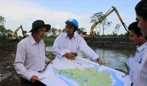 Officials from the water resource department in the Mekong Delta province of Tien Giang inspect saltwater intrusion.